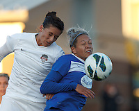 Washington Spirit defender Ali Krieger (11) and Boston Breakers forward Kyah Simon (17) battle for head ball.  In a National Women's Soccer League Elite (NWSL) match, the Boston Breakers (blue) tied the Washington Spirit (white), 1-1, at Dilboy Stadium on April 14, 2012.