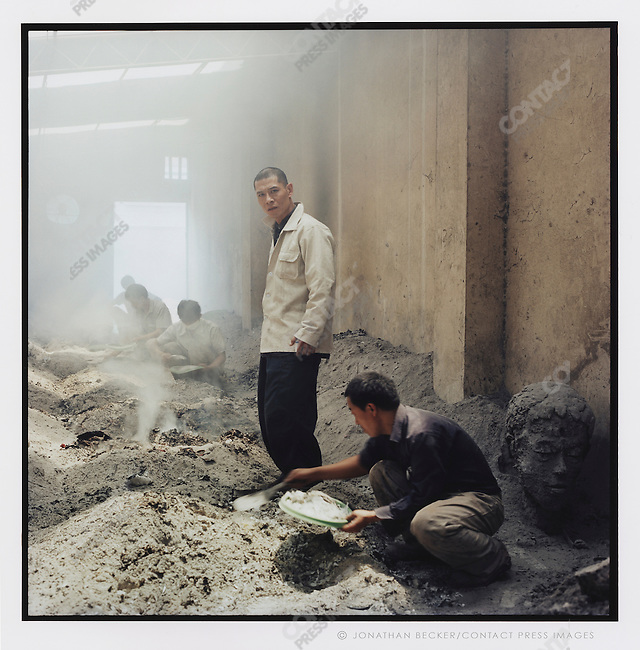 Zhang Huan and assistants in the crematorium of his studio where he creates ash used in his art, Shanghai, China.