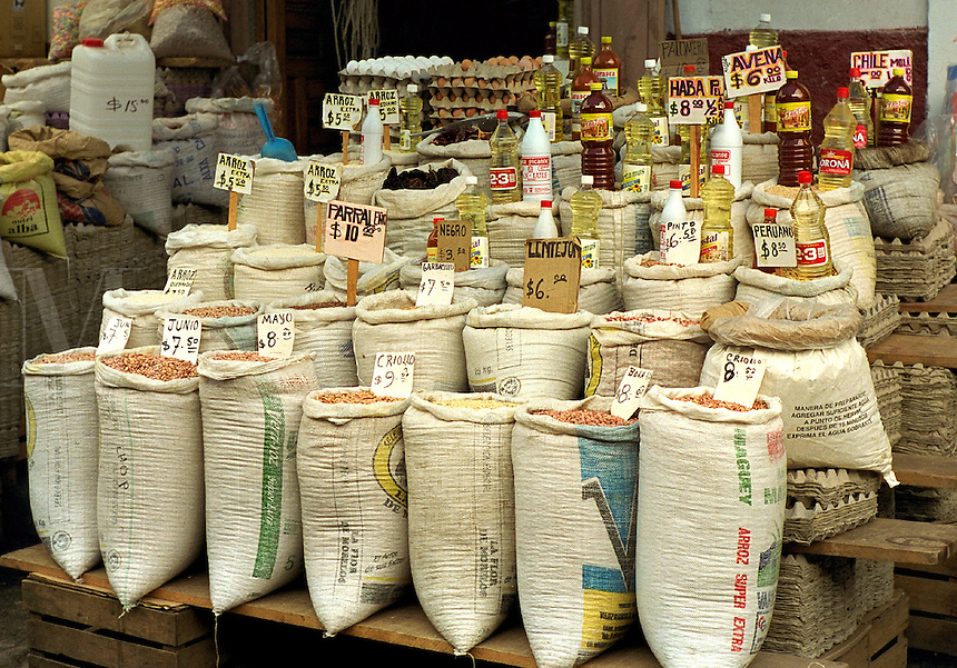 Market stall featuring bulk bags of assorted beans. Patzcuaro Michoacan Mexico.