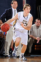 25 February 2012:  FIU guard Tanner Wozniak (23) handles the ball in the first half as the FIU Golden Panthers defeated the University of South Alabama Jaguars, 81-74, at the U.S. Century Bank Arena in Miami, Florida.
