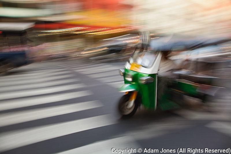 Tuk tuk in motion through Chinatown, Bangkok, Thailand