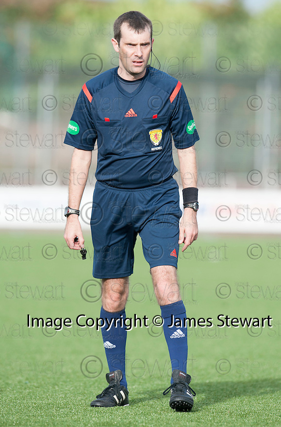 Referee Alan Muir.