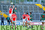 West Kerry's Jimmy O'Grady and St Brendans Jack Barry in action in the qualifier game in the Senior Football Championship game on Sunday.