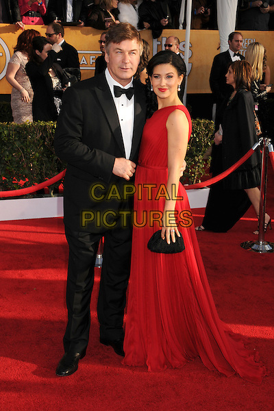 Alec Baldwin & Hilaria Thomas.Arrivals at the 19th Annual Screen Actors Guild Awards at the Shrine Auditorium in Los Angeles, California, USA..27th January 2013.SAG SAGs full length black tuxedo bow tie red one shoulder dress married husband wife.CAP/ADM/BP.©Byron Purvis/AdMedia/Capital Pictures