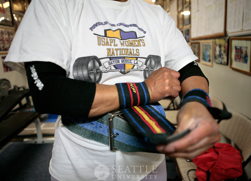 09162009 - Paula Houston, Powerlifter, SU grad student..Houston wraps her wrists tightly before lifting to add support so she can grip and hold heavy weight without worrying about stability.
