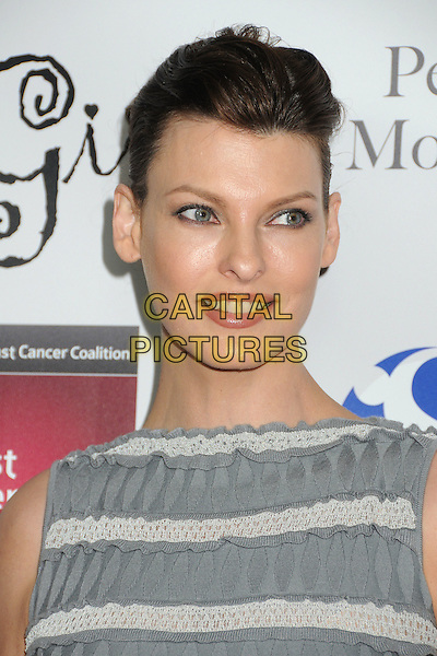 Linda Evangelista.Les Girls Enticing 11th Annual Cabaret Event Held At Avalon, Hollywood, California, USA..October 17th, 2011.headshot portrait white grey gray sleeveless striped stripes .CAP/ADM/BP.©Byron Purvis/AdMedia/Capital Pictures.