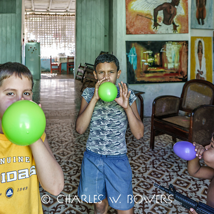Faces Of Cuba - Boys in Trinidad love their gallons.<br />