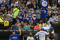 Toronto Blue Jays fans cheer for outfielder Melky Cabrera (53) returning to the dugout after hitting a home run during a game against the Chicago White Sox on August 15, 2014 at U.S. Cellular Field in Chicago, Illinois.  Chicago defeated Toronto 11-5.  (Mike Janes/Four Seam Images)