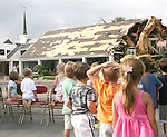 Gary Wilcox/Staff....08/29/07....Christ Episcopal Church Pre-School students watch the deconstruction of the Christ Episcopal Church Parish Hall last Wednesday....