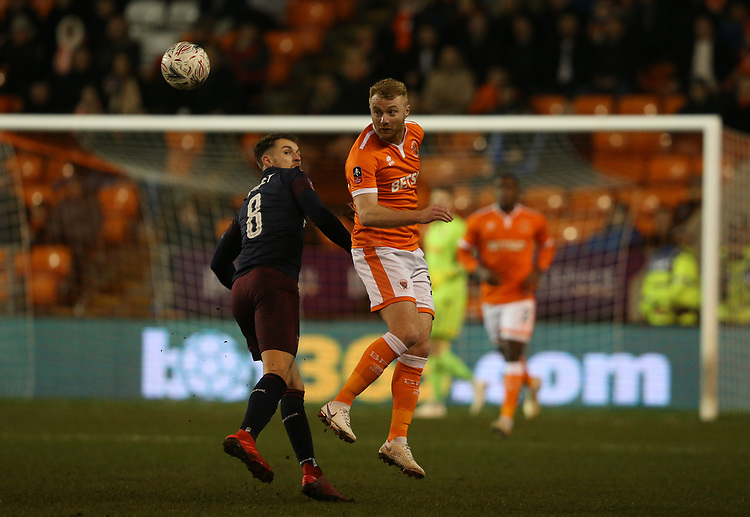 Blackpool's Chris Taylor and Arsenal's Aaron Ramsey<br /> <br /> Photographer Stephen White/CameraSport<br /> <br /> Emirates FA Cup Third Round - Blackpool v Arsenal - Saturday 5th January 2019 - Bloomfield Road - Blackpool<br />  <br /> World Copyright &copy; 2019 CameraSport. All rights reserved. 43 Linden Ave. Countesthorpe. Leicester. England. LE8 5PG - Tel: +44 (0) 116 277 4147 - admin@camerasport.com - www.camerasport.com