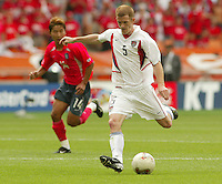 John O'Brien boots the ball forward. The USA tied South Korea, 1-1, during the FIFA World Cup 2002 in Daegu, Korea.