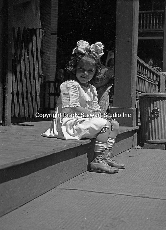 Wilkinsburg PA:  Helen Stewart sitting on the front porch waiting for dad (Brady Stewart) to come home from work - 1919