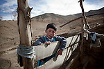 November 2012, Bamiyan, Afghanistan:  Ali Sina (6) at the home of his uncle Sidiq in Bamiyan. His father, Shah Wali has fled via a people smuggler to Indonesia where he is trying to get to Australia. Bamiyan is home to the empty Buddhas of Bamiyan niches, two 6th century monumental statues of standing buddha carved into the side of a cliff in the Bamyan valley in the Hazarajat region of central Afghanistan. The valley is home to many Hazara's, who have often made up vast numbers of refugees to Australia, having been persecuted and driven from their homes in both Afghanistan as well as from Quetta in Pakistan where a lot of displaced Hazara fled to during the Taliban years. Bamiyan is home to a lot of Hazara who are Shia muslim and as such are looked down upon by the Sunni Pashto tribes that make up the population majority in Afghanistan.   Picture by Graham Crouch/The Australian Magazine.