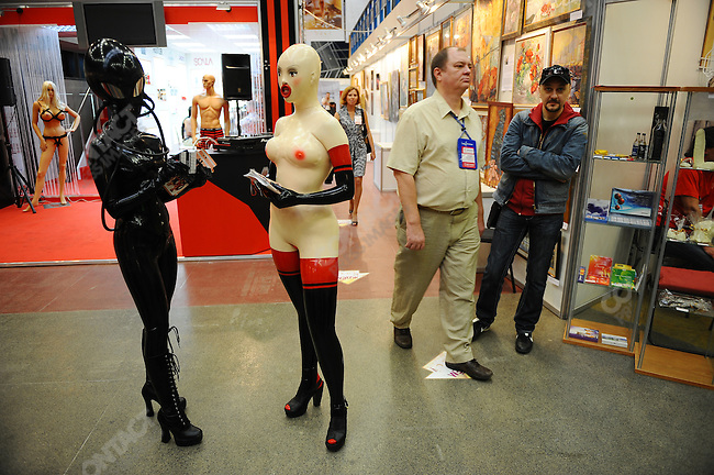 At the X-Show in Moscow, a show with stands selling and promoting businesses involved in the erotic industry, girls dressed up in latex outfits handed out flyers. Moscow, Russia, May 28, 2010