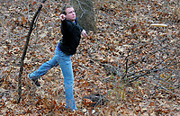 NWA Democrat-Gazette/DAVID GOTTSCHALK Andrew Gabbard, of Fayetteville, throws out of the rough for a second shot Monday, January 8, 2017, on the first hole of the disc golf course at J.B. Hunt Park in Springdale. Gabbard was playing with his brother Nathan from Joplin.