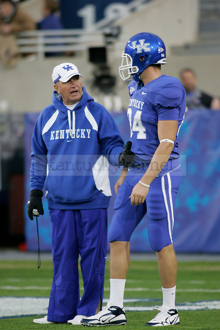 UK coach Rich Brooks talks to tight end Gabe Correll before the game against Mississippi State at Commonwealth Stadium on Saturday, Oct. 31, 2009. Photo by Adam Wolffbrandt | Staff