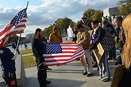 November 11, 2011  (Washington, DC)  Members of OccupyDC have a moment of silence at the World War II Memorial in Washington on Veteran's Day 2011.  (Photo by Don Baxter/Media Images International)