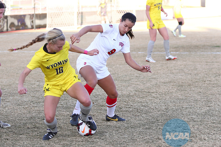 04 NOV 2013:  Freshman midfielder Mandy Meyer (#10) of The University of Wyoming battles senior forward Jenn Wolfe (#9) of UNLV during Game 1 of the Mountain West Conference Women's Soccer Championship held at the UNM Soccer Complex in Albuquerque, NM. Wyoming advanced  4-2 on penalty kicks. (Juan Labreche/NCAA Photos)