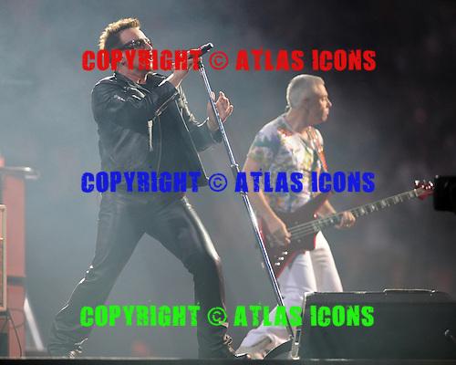 MIAMI GARDENS, FL - JUNE 29:  Bono and Adam Clayton of U2 perform at Sun Life Stadium on June 29, 2011 in Miami Gardens, Florida. Credit Larry Marano (C) 2011