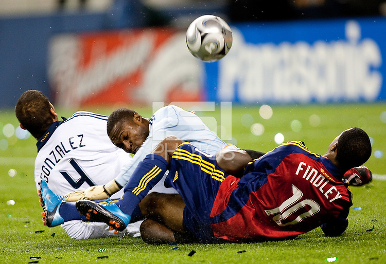 SEATTLE, WA--LA Galaxy goalkeeper Donovan Ricketts tangles with teammate Omar Gonzalez, and Real Salt Lake's Robbie Findley during the MLS Cup championships at Qwest field in Seattle. SUNDAY, NOVEMBER 22, 2009. PHOTO BY DON FERIA.