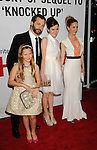 HOLLYWOOD, CA - DECEMBER 12: Judd Apatow, Maude Apatow, Iris Apatow and Leslie Mann arrive at the 'This Is 40' - Los Angeles Premiere at Grauman's Chinese Theatre on December 12, 2012 in Hollywood, California.