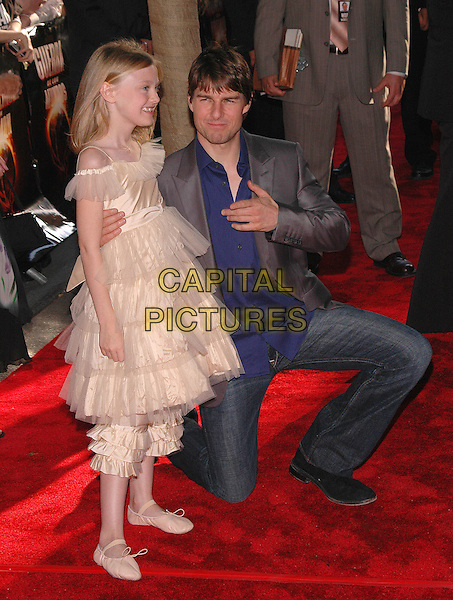 "DAKOTA FANNING & TOM CRUISE .New York premiere of their new film, ""War Of The Worlds"" at the Ziegfeld Theater, New York, New York.June 23rd, 2005.Photo Credit: Patti Ouderkirk/AdMedia.full length kneeling crouching ruffles layers ballet shoes knickers jeans denim .www.capitalpictures.com.sales@capitalpictures.com.© Capital Pictures."