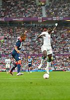 July 26, 2012..Britain's Ryan Bertrand (3) and Senegal's Idrissa Gueye (14).  Great Britain vs Senegal Football match during 2012 Olympic Games at Old Trafford in Manchester, England. Senegal held Great Britain to a 1-1 draw...(Credit Image: © Mo Khursheed/TFV Media)