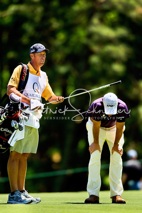 An ill Phil Mickelson (right) during the ProAm at the Quail Hollow Championship at Quail Hollow Country Club on May 2, 2010 in Charlotte, North Carolina.  The event, formerly called the Wachovia Championship, is a top event on the PGA Tour, attracting such popular golf icons as Tiger Woods, Vijay Singh and Bubba Watson. Photo from the final round in the Quail Hollow Championship golf tournament at the Quail Hollow Club in Charlotte, N.C., Sunday , May 03, 2009..