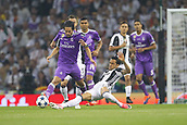 June 3rd 2017, National Stadium of Wales , Wales; UEFA Champions League Final, Juventus FC versus Real Madrid; Dani Alves of Juventus slides in to tackle Isco of Real Madrid