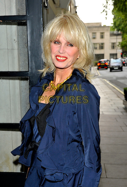 Joanna Lumley  .Attend an Evening with Downton Abbey - Raising Money for Merlin, The Medical relief charity, Savoy Hotel, London., England..July 14th, 2011.half length dress blue blazer jacket  side.CAP/CJ.©Chris Joseph/Capital Pictures.