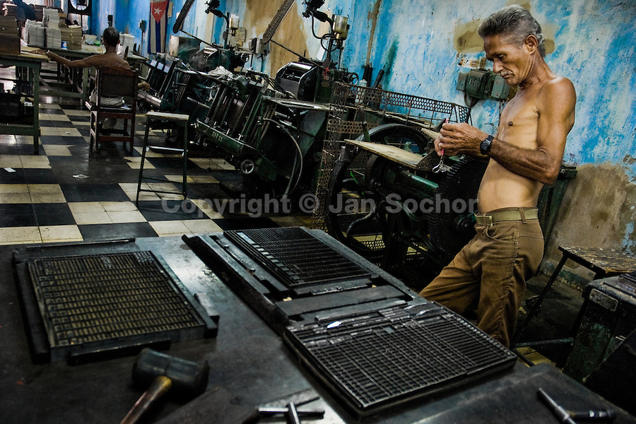 A Cuban master printer, leant against a printing machine, waits for a new load in the state print shop, Santiago de Cuba, Cuba, 4 August 2008. About 50 years after the national rebellion, led by Fidel Castro, and adopting the communist ideology shortly after the victory, the Caribbean island of Cuba is the only country in Americas having the communist political system. Although the Cuban state-controlled economy has never been developed enough to allow Cubans living in social conditions similar to the US or to Europe, mostly middle-age and older Cubans still support the Castro Brothers' regime and the idea of the Cuban Revolution. Since the 1990s Cuba struggles with chronic economic crisis and mainly young Cubans call for the economic changes.