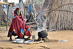 Fatna cooks for her family in a camp for internally displaced persons outside Kubum, in South Darfur.