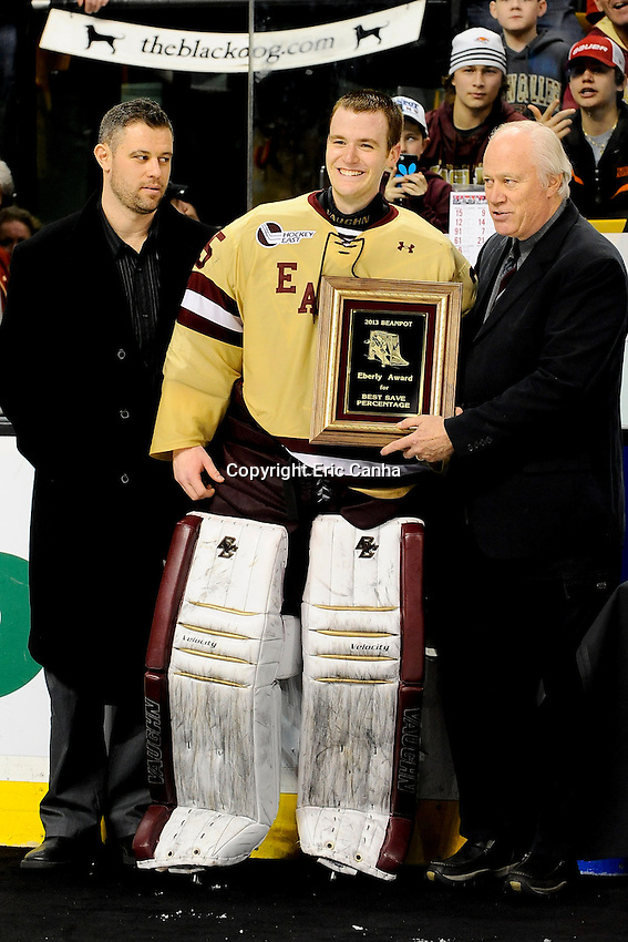 Boston College goaltender Parker Milner (35) is presented the Eberly Award for best save percentage at the Beanpot Tournament held at TD Garden in Boston Massachusetts.  Eric Canha/CSM