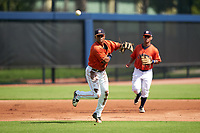 GCL Astros third baseman Rolando Espinosa (10) throws to first base during a Gulf Coast League game against the GCL Mets on August 10, 2019 at FITTEAM Ballpark of the Palm Beaches Training Complex in Palm Beach, Florida.  GCL Astros defeated the GCL Mets 8-6.  (Mike Janes/Four Seam Images)