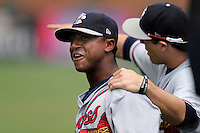 Shortstop Ozhaino Albies (7) of the Rome Braves, left, jokes with a teammate before a game against the Greenville Drive on Sunday, June 14, 2015, at Fluor Field at the West End in Greenville, South Carolina. Rome won, 5-2. (Tom Priddy/Four Seam Images)