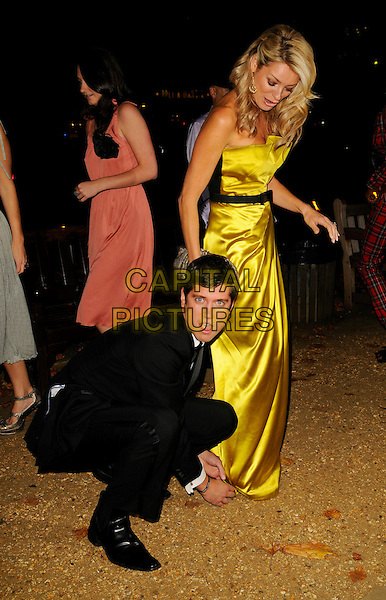 "VERNON KAY & TESS DALY.The ""End of Summer Ball"" at Berkeley Square, London, England, .September 25th 2008..full length strapless yellow gold silk satin long dress maxi black belt clutch bag dress funny kneeling married couple husband wife suit fixing.CAP/CAN.©Can Nguyen/Capital Pictures"