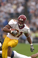 27 September 2003:  Marion Barber III (21), Minnesota RB, avoids a tackle and runs away from Penn State's Jimi Mitchell (38) on his way to a TD run.  Minnesota defeated Penn State 20-14  at Beaver Stadium in State College, PA.<br />