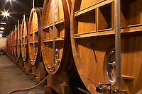 Wooden storage vats with aging wine in the cellar of Guigal in Ampuis.   Domaine E Guigal, Ampuis, Cote Rotie, Rhone, France, Europe