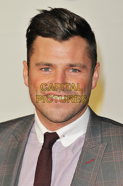 Mark Wright .Brit Awards 2013 at the O2 Arena, North Greenwich, London, England, UK, .20th February 2013..portrait headshot grey gray white shirt red tie suit smiling plaid checked striped pinstripe brits arrivals.CAP/WIZ.© Wizard/Capital Pictures.