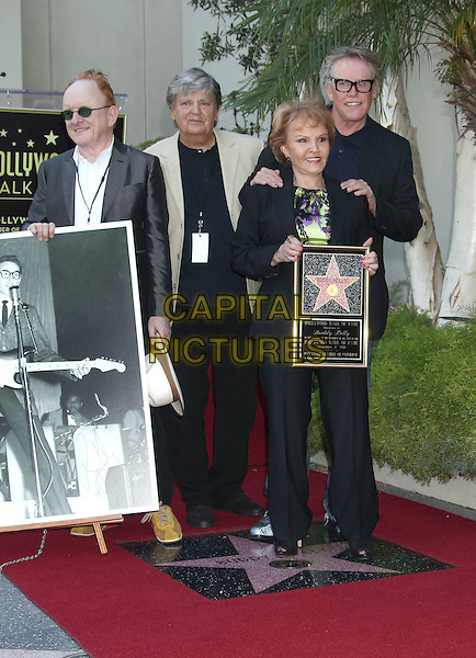 "Peter Asher, Phil Everly and Gary Busey and Maria Elena Holly.Buddy Holly posthumous STAR Induction into ""The Hollywood Walk of Fame"" on his 75th Birthday held in front of the Capital Records Building on Vine Street, Hollywood, California, USA..September 7th, 2011.full length grey gray blue black white beige suit hands on shoulders plaque picture photograph glasses .CAP/ADM/RE.©Russ Elliot/AdMedia/Capital Pictures."
