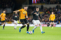 4th January 2020; Molineux Stadium, Wolverhampton, West Midlands, England; English FA Cup Football, Wolverhampton Wanderers versus Manchester United; Matt Doherty of Wolverhampton Wanderers as Andreas Pereira of Manchester United  comes in to tackle - Strictly Editorial Use Only. No use with unauthorized audio, video, data, fixture lists, club/league logos or 'live' services. Online in-match use limited to 120 images, no video emulation. No use in betting, games or single club/league/player publications