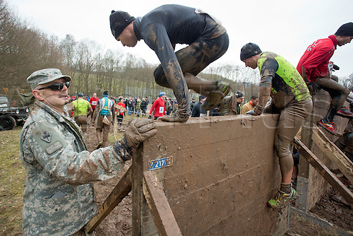 12.03.2016. Bischofsheim, Germany.  A participant of the extreme run Braveheart Battle climbing an obstacle in Bischofsheim, Germany. Almost 2,700 runners have to manage a 30 kilometer track with 45 obstacles. The extreme run event leads through ice cold water, deep mud pits and hot fire obstacles. It is said to be one of the hardest in Europe.