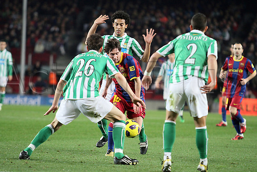 12.01.2011 Spanish Copa del Rey from the Camp Nou. Barcelona v Real Betis. Picture shows ..Messi fighting with the defenders