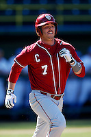Max White #7 of the Oklahoma Sooners runs to first base during a baseball game against the UCLA Bruins at Jackie Robinson Stadium on March 9, 2013 in Los Angeles, California. (Larry Goren/Four Seam Images)