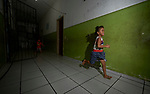 Five-year old Deborah runs through the hallway of a building her family occupied last year in Manaus, Brazil. The Kokama indigenous family migrated to the city in 2018, joining with other poor families to take over an unoccupied building--the Casa do Estudante--in the city center.<br /> <br /> Written parental consent obtained.