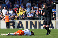 Referee Martin Coy shows concern for Blackpool's Antony Evans after he goes down injured<br /> <br /> Photographer David Shipman/CameraSport<br /> <br /> The EFL Sky Bet League One - Scunthorpe United v Blackpool - Friday 19th April 2019 - Glanford Park - Scunthorpe<br /> <br /> World Copyright © 2019 CameraSport. All rights reserved. 43 Linden Ave. Countesthorpe. Leicester. England. LE8 5PG - Tel: +44 (0) 116 277 4147 - admin@camerasport.com - www.camerasport.com