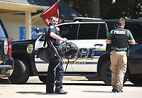 NWA Democrat-Gazette/DAVID GOTTSCHALK  A member of the Fayetteville Police Department collects his gear Friday, September 6, 2019, at the Greens Apartments at 2691 N. Club where a man barricaded himself inside who is a suspect in a shooting Thursday night.