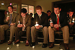 Brothers from the Delta Sigma Phi fraternity sit during a moment of silence at the Candlelight Vigil for Alex Ehr in the Newman Center in Lexington, Ky., on 2/23/12. Photo by Brandon Goodwin | Staff
