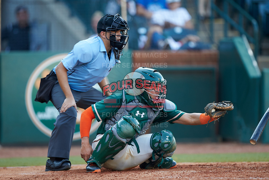 Greensboro Grasshoppers catcher Will Banfield (18) frames a pitch as home plate umpire Josh Gilreath looks on during the game against the West Virginia Power at First National Bank Field on August 9, 2018 in Greensboro, North Carolina. The Power defeated the Grasshoppers 5-3 in game one of a double-header. (Brian Westerholt/Four Seam Images)