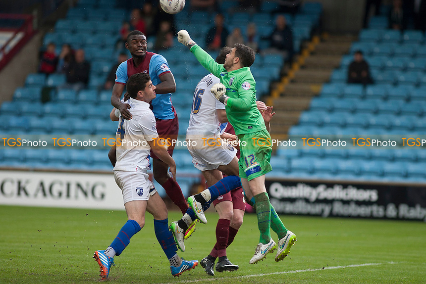 keeper Glenn Morris of Gillingham punches clear<br />  - Scunthorpe United vs Gillingham - Sky Bet League One Football at Glanford Park, Scunthorpe, Lincolnshire - 25/04/15 - MANDATORY CREDIT: Mark Hodsman/TGSPHOTO - Self billing applies where appropriate - contact@tgsphoto.co.uk - NO UNPAID USE
